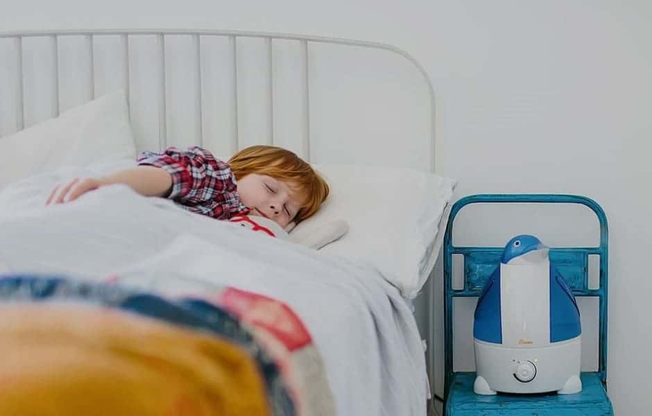 Child sleeping with cool mist humidifier